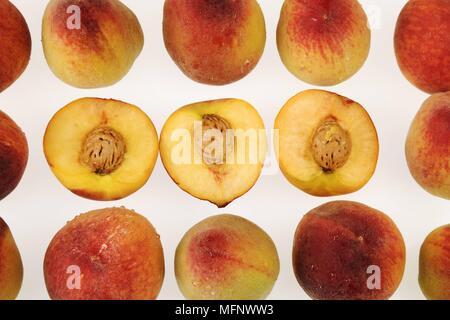 Fresh peaches. White background. Studio shot.         Ref: CRB538_103609_0032  COMPULSORY CREDIT: Martin Harvey / Photoshot - Stock Image
