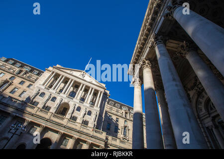 A view of the exterior of The Bank of England - the central bank of the UK, with the Royal Exchange building on the right-handside in London, UK. - Stock Image