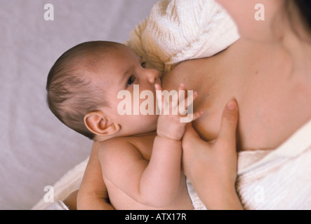 30 year old Brazilian American mother breastfeeding her son - Stock Image