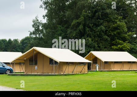Glamping Tents at the Windermere Camping and Caravanning Club site, well-equipped semi-permanent pre-erected two-bedroom, six berth safari tents. - Stock Image