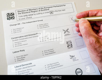 Man voting on Scottish ballot paper for  Change UK party in European Parliament election, Scotland, May 2019 - Stock Image