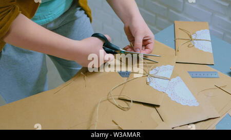 Professional woman decorator, designer working with kraft paper - Stock Image