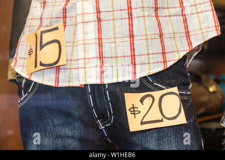 Miami Beach Florida Collins Avenue window display store shop shopping business retail apparel clothing fashion sign price $20 $1 - Stock Image