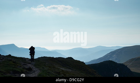 A hiker walking along Littledale Edge between Dale Head and Robinson, Buttermere Fell in the Lake District - Stock Image