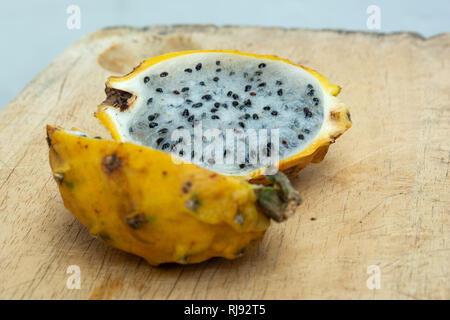 Yellow Dragon Fruit or Pitaya (Pitahaya) cut open to show interior flesh - Stock Image