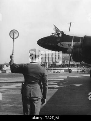 A Focke-Wulf FW 200 Condor (tail number D-AETA, given name 'Westfalen') at the Berlin-Tempelhof Airport. - Stock Image