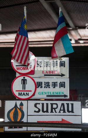 Signs at Central Market, Kota Kinabalu, Sabah, include directions to a surau or prayer hall for Muslims, as well as the washrooms. - Stock Image