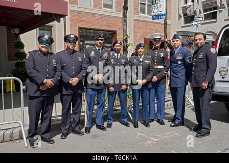 Sikh police & corrections officers and soldiers pose prior to the Sikh Day Parade in Manhattan, New York City. - Stock Image