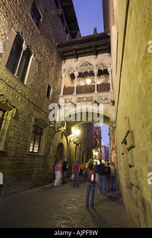 Barcelona Barri Gotic Carrer del Bisbe at twilight people - Stock Image