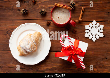 Christmas present and croissant - Stock Image