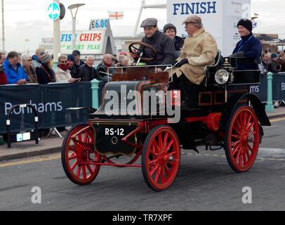 Mr Barry Weatherhead driving his1900 Daimler, across the finishing line of the 2018 London to Brighton Veteran Car Run - Stock Image