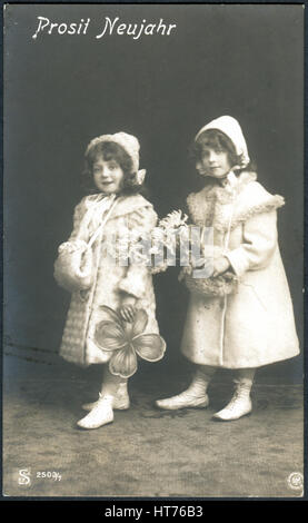 GERMANY - CIRCA 1907: A postcard printed in Germany, shows two little girls. The inscription in German: Happy New - Stock Image