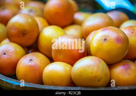 Fresh oranges in local market. Selected close up focus. - Stock Image