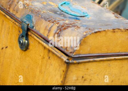 Yellow trunk in scrap yard - Stock Image