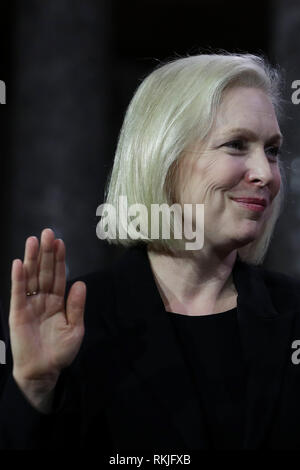 US Senator Kirsten Gillibrand, Democrat of New York, is sworn in by Vice President Mike Pence on Capitol Hill in Washington, DC on January 3, 2019. - Stock Image