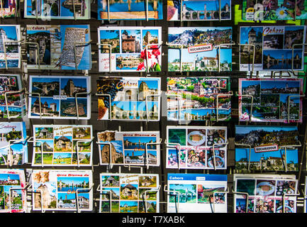Cahors, France - May 1st, 2019: Southwest France postcards on display including touristic towns such as Cahors - Stock Image