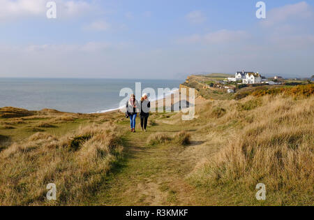Coastal path walk along the cliffs above Burton Bradstock in West Dorset UK - Stock Image