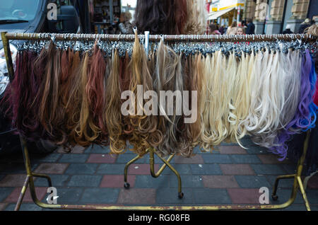 Display of artificial hair for women on sale at the weekly market in Darlington County Durham UK - Stock Image