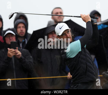 Portrush, County Antrim, Northern Ireland. 17th July 2019. The 148th Open Golf Championship, Royal Portrush Golf Club, Practice day ; Tommy Fleetwood (ENG) follows the flight of his tee shot on the 14th hole Credit: Action Plus Sports Images/Alamy Live News - Stock Image