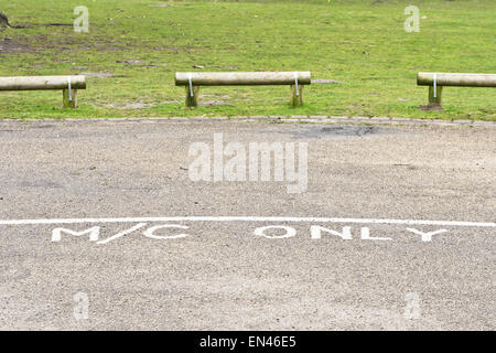 Designated parking area for motorcycles in a public park in the UK - Stock Image