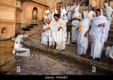 Indian Hindu widows on the banks of Yamuna river in Vrindavan , India - Stock Image