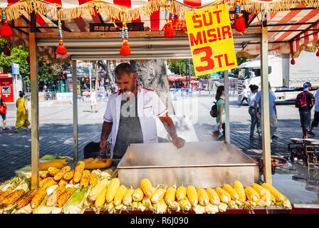 Istanbul, Turkey, August 14, 2018: A street vendor cooks corn at the Sultanahmet Square on August 14, 2018, in Istanbul, Turkey - Stock Image