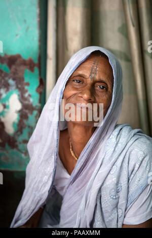 Portrait of Hindu widow woman living in an ashram in Vrindavan , India - Stock Image