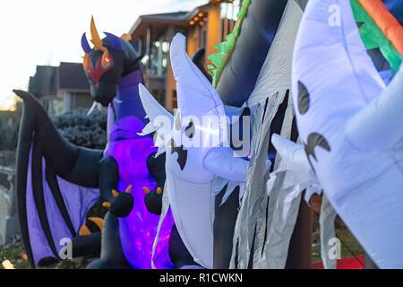 Halloween decorations in front of neighborhood houses - Stock Image