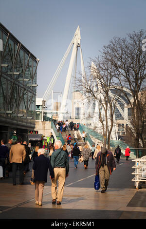 People walking towards the Golden Jubillee Bridge from the southbank in London - Stock Image