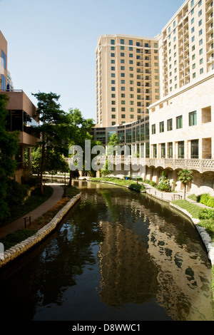 View of the Riverwalk and hotels alongside, San Antonio, Texas - Stock Image