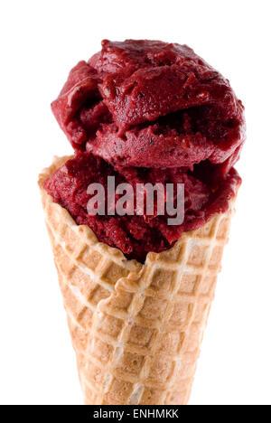 Sorbet ice cream in waffle cone. - Stock Image