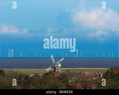 Cley windmill with the Sheringham shoal wind-farm in the distance. - Stock Image