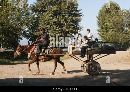 Azerbaijan, Sheki (Shaki), between Georgia border and Sheki, horse drawn cart with people - Stock Image