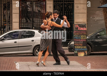 It is common to find tango dancers in the Plaza Dorrego of the historic center of San Telmo, Buenos Aires, Argentina, who offer their art to tourists. - Stock Image