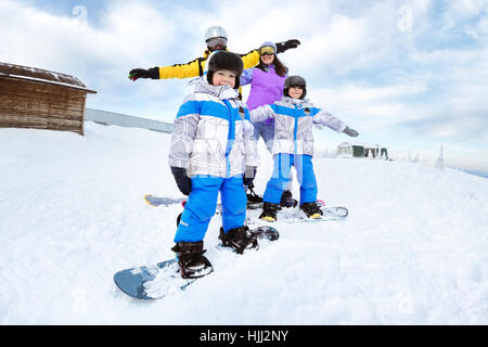 Happy family snowboarder snowboarding winter - Stock Image