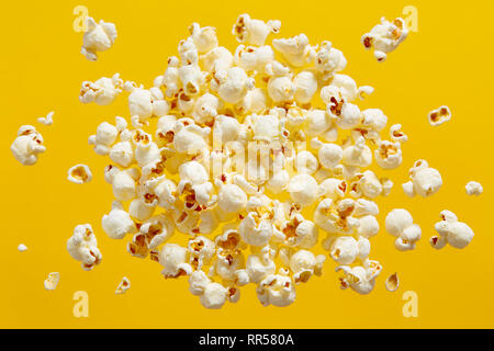 Close-Up Of Popcorn Against Yellow Background - Stock Image