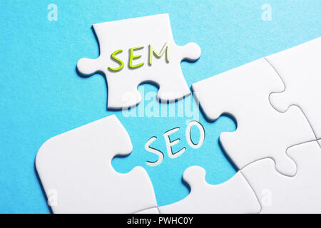 The Words SEO And SEM In Missing Piece Jigsaw Puzzle - Stock Image
