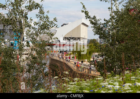 View south along River Lea with Aquatics Centre on a sunny day at Olympic Park, London 2012 Olympic Games site, - Stock Image