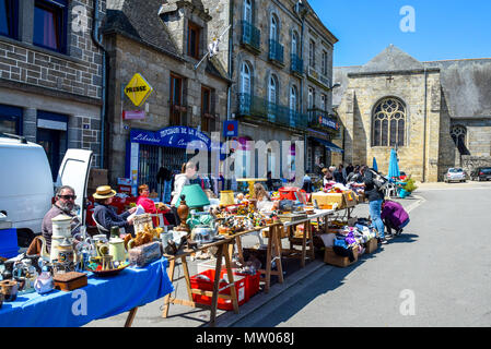 A very sunny market day in the town square in Rostrenan, Brittany, France. - Stock Image