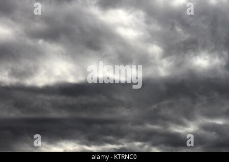 Deep grey and white storm clouds. - Stock Image