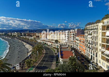 View of the sunny promenade des Anglais with its pebble beach of the city of Nice in french riviera (Winter 2018) - Stock Image