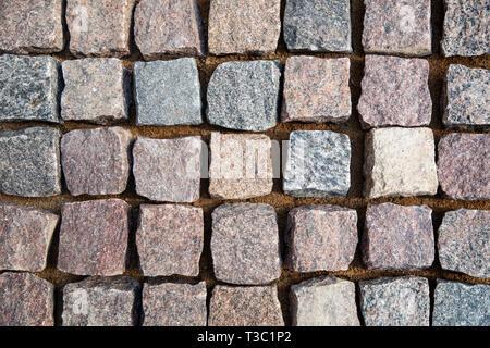 natural granite stone cobblestone. top view - Stock Image