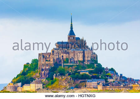 Mont St Michel on a cloudy & wet day in Normandy, France. The Benedictine Monks set up a commune here in 966 - Stock Image