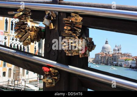 Love locks on Ponte dell'Accademia bridge, Venice, Italy - Stock Image