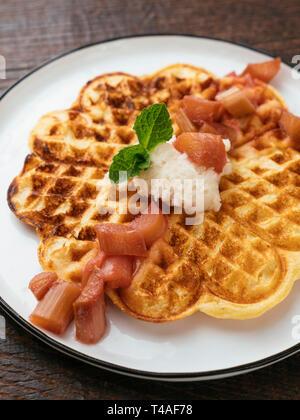 Vegan Waffles with Rhubarb Sauce - Stock Image