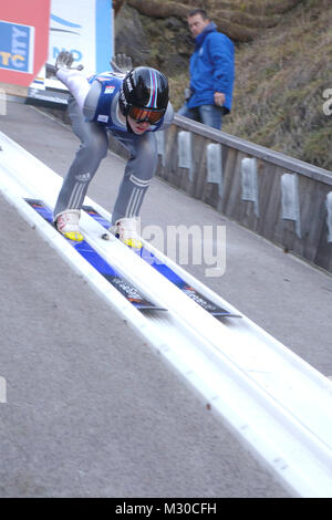 Forerunner starts off prior to the start of the world championship for women at the start point of Ski Jumping Hill, - Stock Image