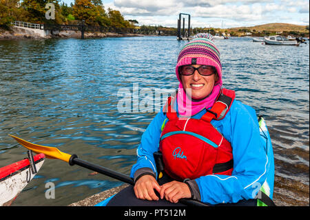 Schull, West Cork, Ireland. 6th Oct, 2018.  On a beautiful day in West Cork, Amy Walsh from Courtmacsherry prepares to go kayaking. Today's activities culminate this evening in a dinner dance at the Schull Harbour Hotel. Credit: Andy Gibson/Alamy Live News. - Stock Image