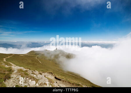 Scenic view of clouds on mountain against sky - Stock Image