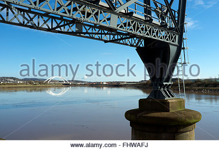 The River Usk in Newport, with part of the Transporter Bridge in foreground, and the City Bridge in distance. Newport, - Stock Image