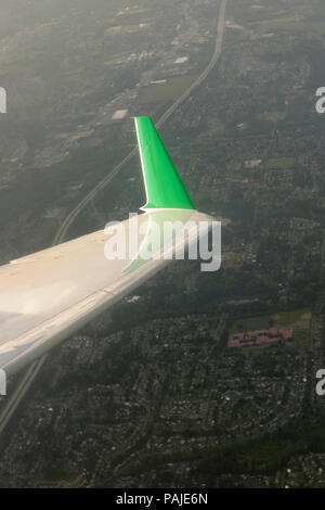 winglet of Air Canada Jazz Bombardier CRJ-100ER flying enroute - Stock Image